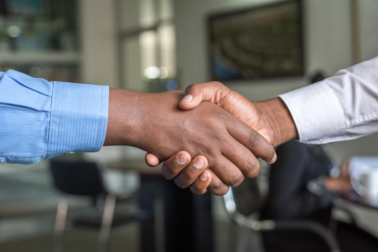 tenant and landlord shaking hands