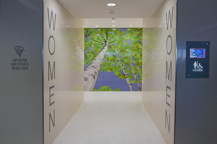 Photo of women's restroom art wall on Concourse F at Terminal 1. Artist is Barbara Keith.
