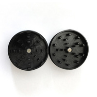 "Black Two Piece Shredding Type Grinder With a 2.5"" Diameter"