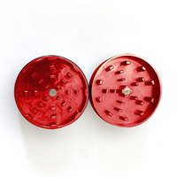 "Red Two Piece Shredding Type Grinder With a 2.5"" Diameter"