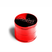 "Red Four Piece Shredding Type Grinder With a 2.5"" Diameter"