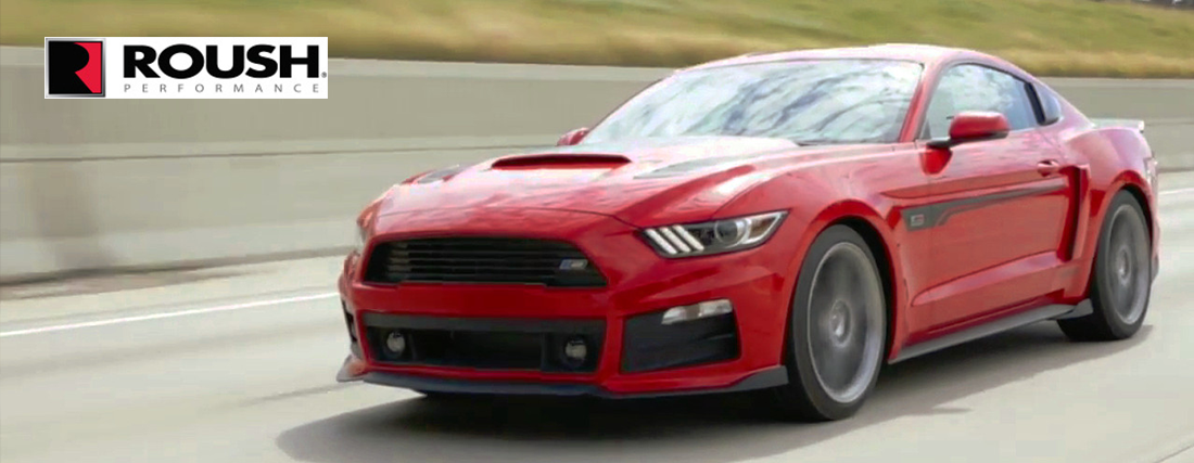 red stage 2 roush mustang racing down the highway