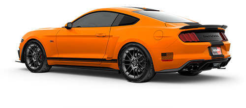 drivers side view of a yellow stage 2 roush mustang