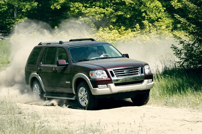new maroon ford explorer on a dirt road in Alpharetta GA