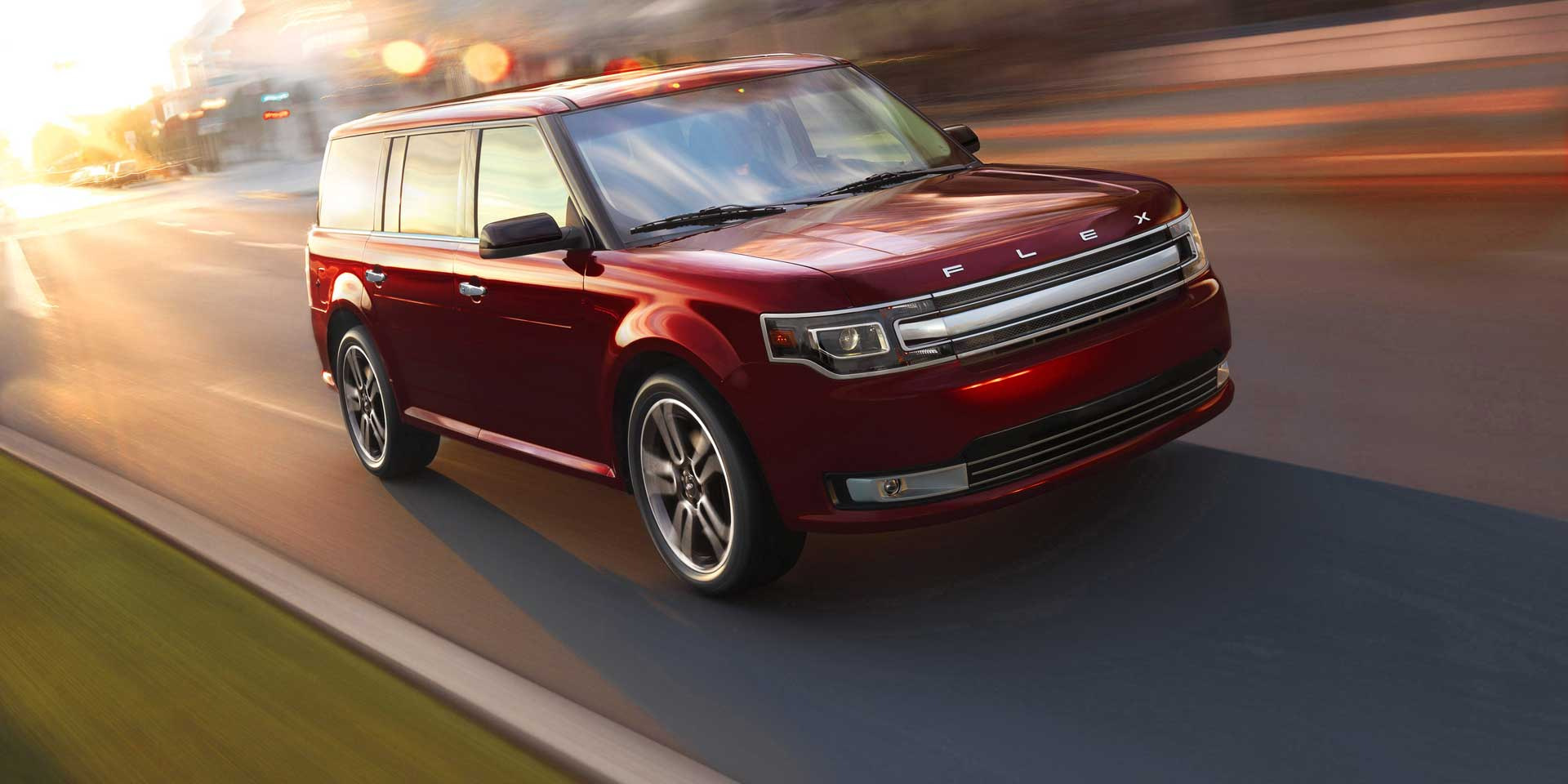 new red ford flex driving down Alpharetta street.