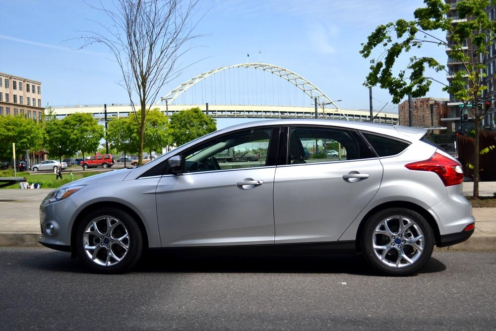 silver 4 door ford focus parked on the street in alpharetta ga