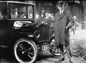 Henry Ford next to a black ford car