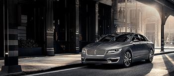 new gray lincoln sedan driving down mansell rd in Alpharetta GA