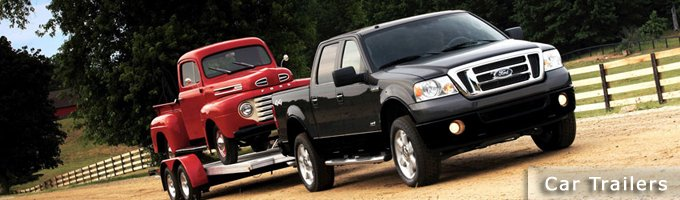 black ford f150 towing a red pickup with a featherlite car trailer