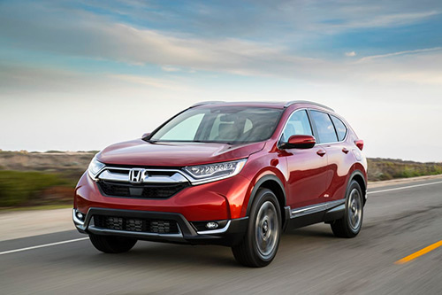 New red 2019 honda crv driving in Jacksonville FL.