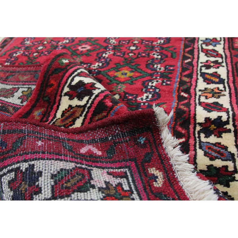 Inspect the front and back of a rug