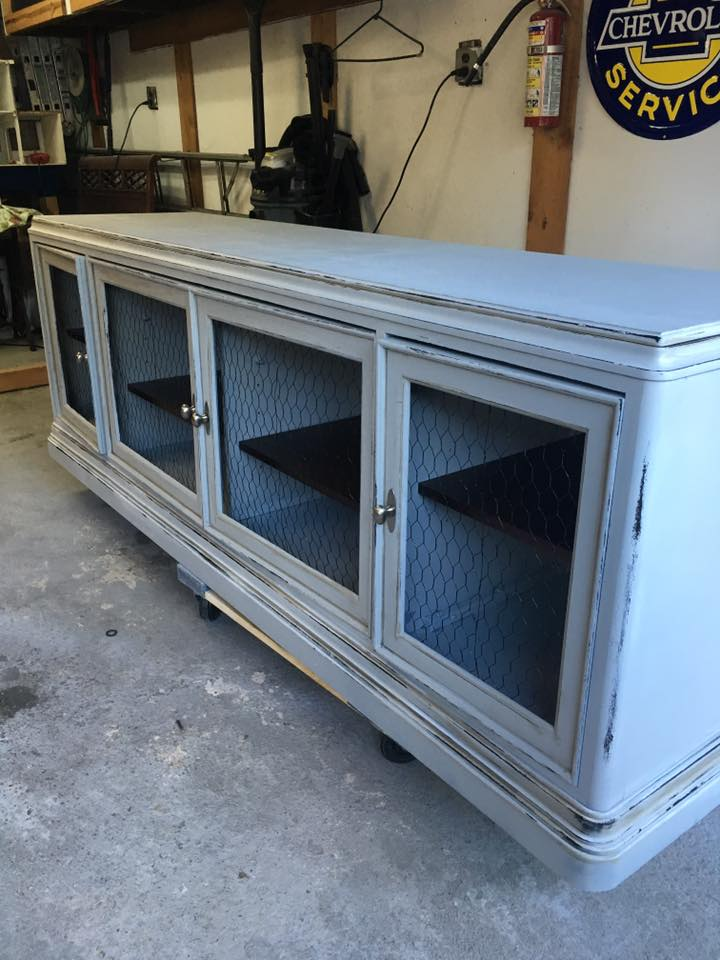 What a beautiful piece completely redone by customer Heather L. in Farmhouse Paint's Creamy Linen then distressed it for an aged look! We love how Heather redid the cabinet doors using chicken wire. The definition of Farmhouse beautiful!