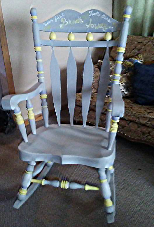 The hand-painted artistic rocking chair was painted in Farmhouse Paint's Ancient Gray and Sunshine Yellow. This adorable piece was completed by Annie Marie V.