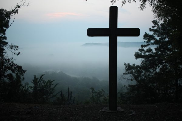 Cross Silhouetted on Mountain
