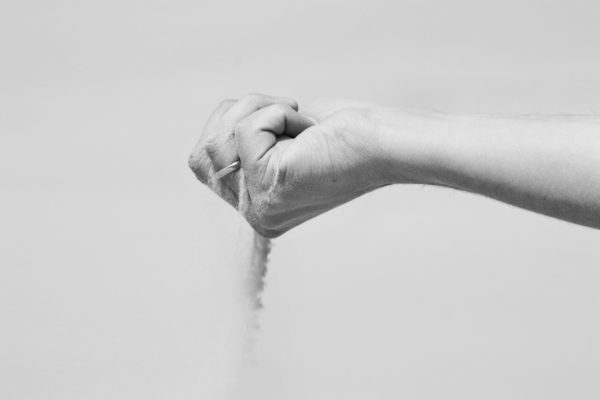 Hand Holding Dust