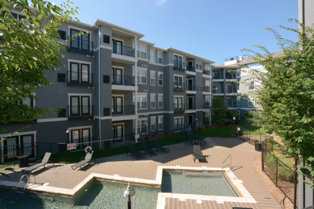 Brand new and open apartment exterior with swimming pool encourages a sense of community