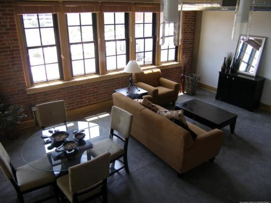 Open GW Loft interior with exposed brick walls