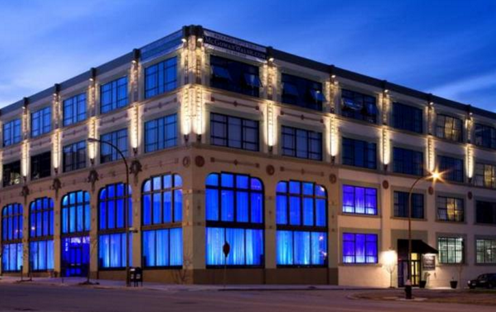 The beautiful Packard Lofts building illuminated at night