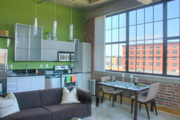 A modern industrial Packard Loft living space with huge windows