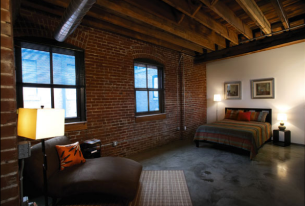 Spacious Majestic Stove Loft with exposed beams and brick walls
