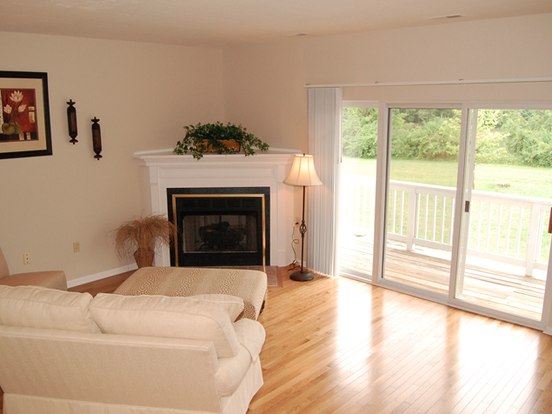 Beautiful Cove and Point Condo living room with decorative fireplace and private patio