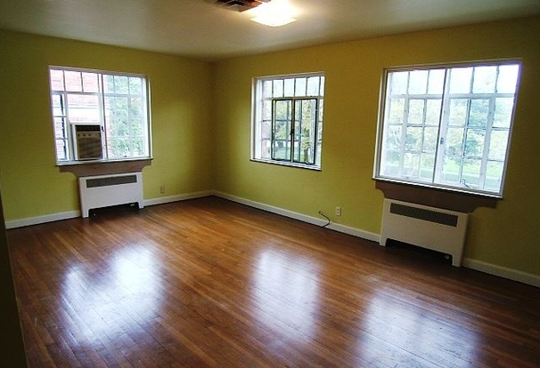 Open and bright La Grande Jatte apartment living space with gorgeous hardwood floors