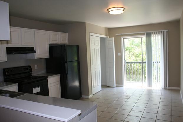 Roomy full kitchen with outdoor balcony in Landmark on Longmire apartment