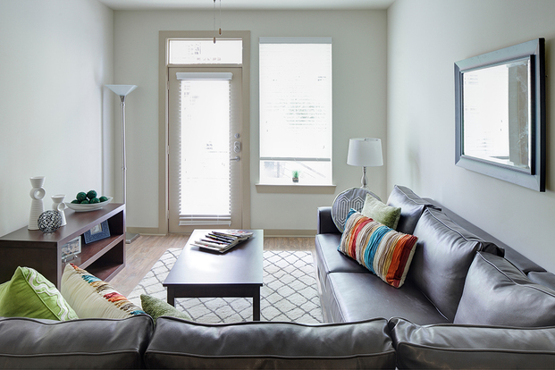 Bright Northpoint Crossing living room with oversized windows and private balcony