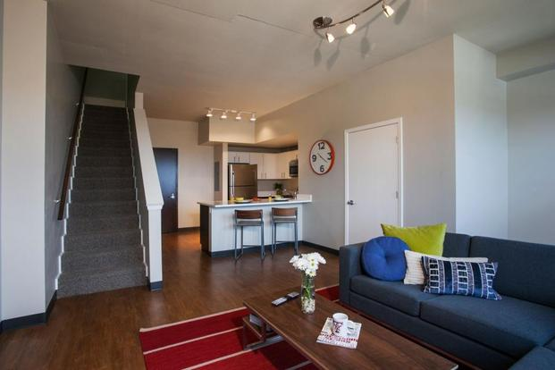 Sleek and modern Rise at Northgate apartment with designer lighting and hardwood floors
