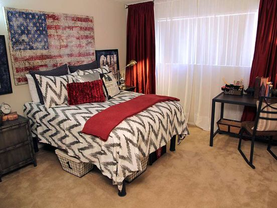 Spacious bedroom with long windows and plush carpet in Stadium View apartment