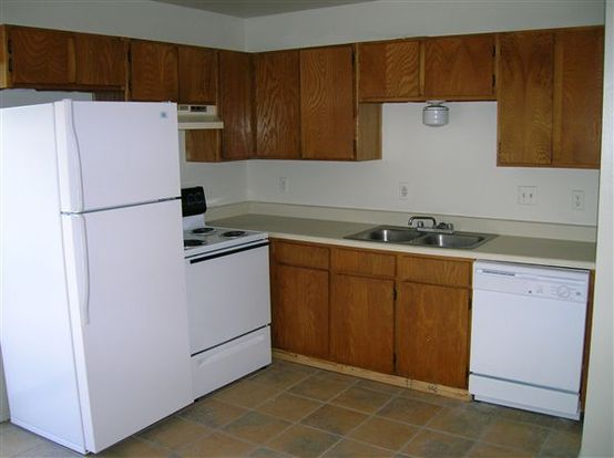 Large Verde Townhouse Style Fourplex kitchen with full appliances and double sink