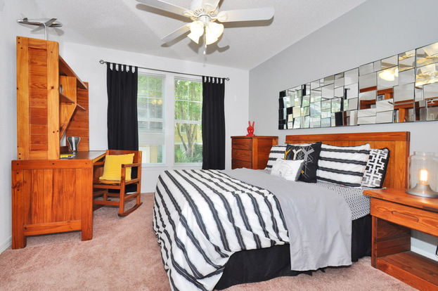 Large Campus Club apartment bedroom with oversized windows