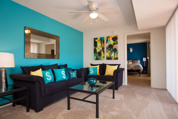 Bright Lexington Crossing apartment living room with carpeted floors