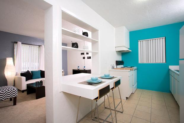 Sleek kitchen in a Frederick Gardens apartment with breakfast bar