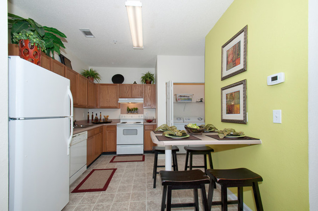 Spacious kitchen with beautiful cabinets at Gainesville Place