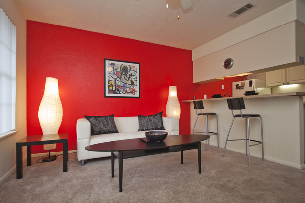 Generously sized Oxford Manor apartment living room with breakfast bar