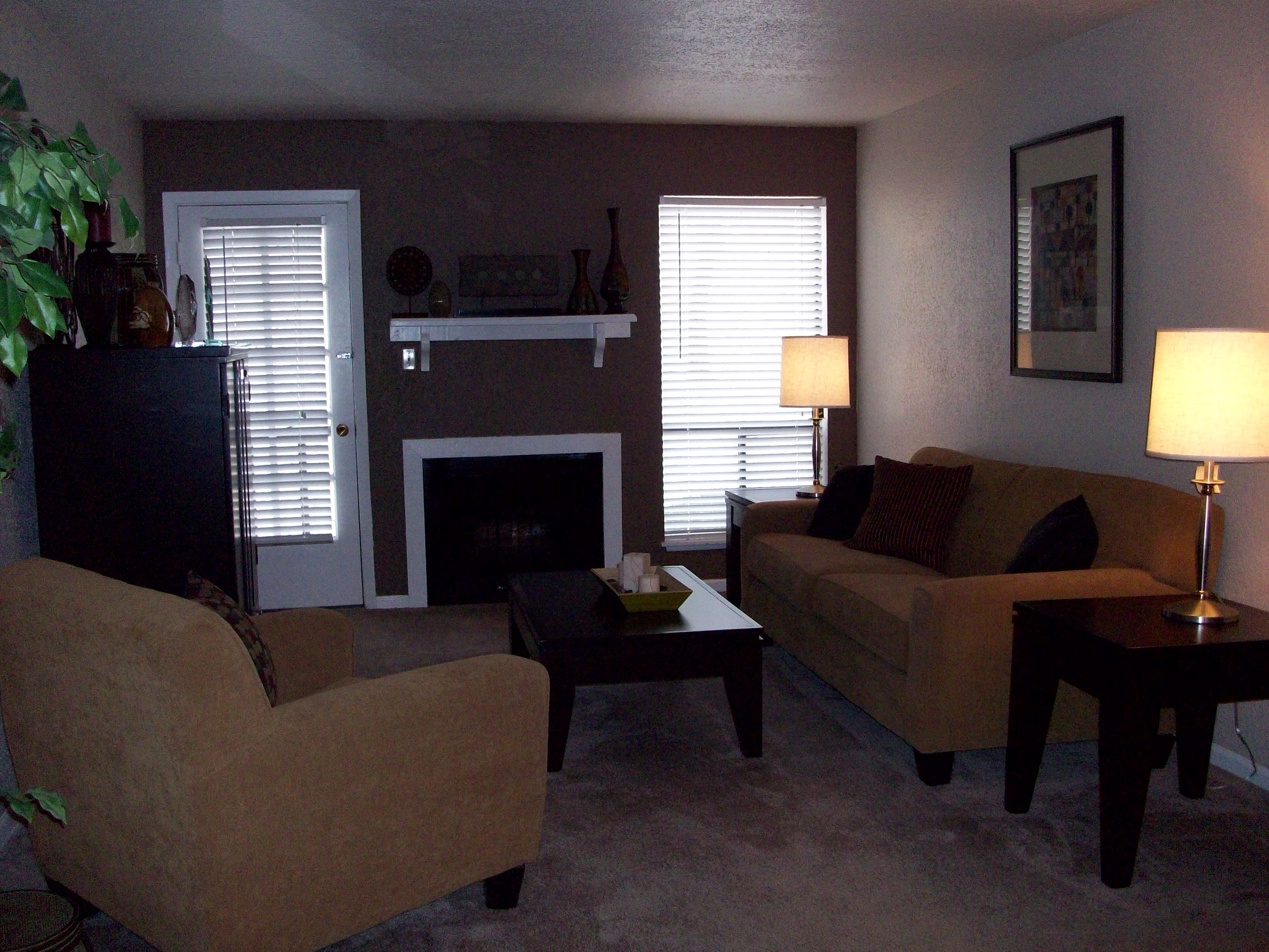 Intimate living room with fire place & huge windows in Stonehaven South Apartment