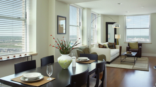 Upscale 909 Walnut apartment with wide open windows & hardwood floors