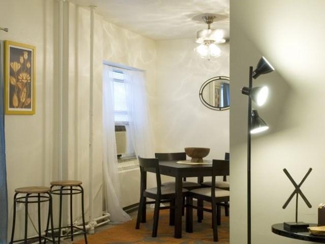 Roomy Six40 studio with large windows & plush carpet