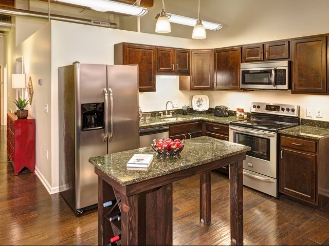 This stylish kitchen in a Downtown Pittsburgh apartment with stainless steel appliances (including a dishwasher) would be perf for cutting down clean up time after cooking!