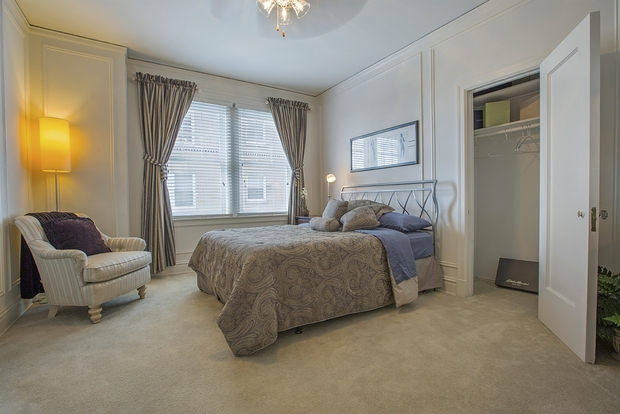 Large Central West End City bedroom with oversized windows and ample closet space