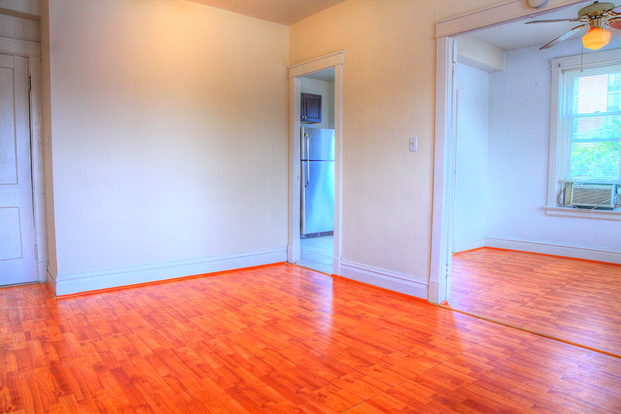 Large Park Lane living space with hardwood floors