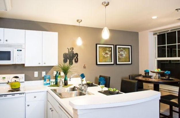 Designer kitchen with breakfast bar at Residences at Forest Park Hotel