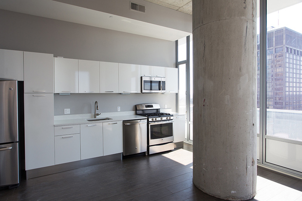 Tower at Opop's designer kitchen with stainless steel appliances and modern white fixtures