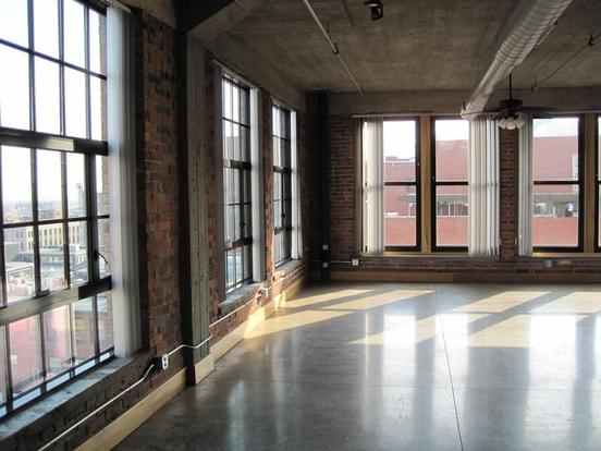 Bright and stylish Fashion Square Loft with huge windows and exposed brick walls