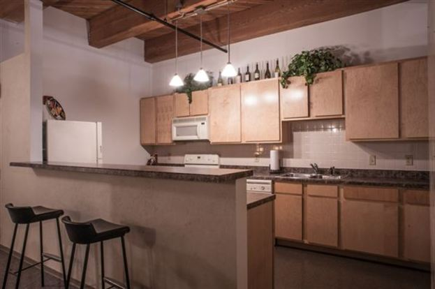 Conveniently designed Vangard Lofts Kitchen with breakfast bar