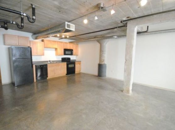 Huge 1818 Washington Avenue kitchen and living space with loft details and designer lighting