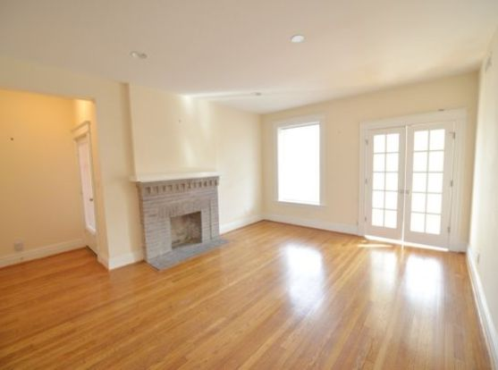 Spacious 721 Limit Avenue living space with open floor plan and decorative fireplace