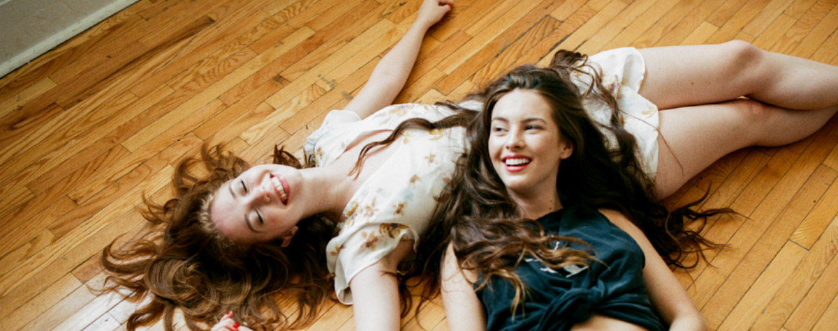 Best friends laughing together on the floor