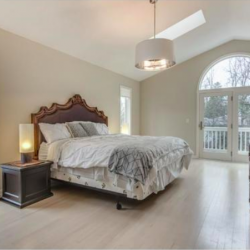 This bedroom has a skylight and balcony